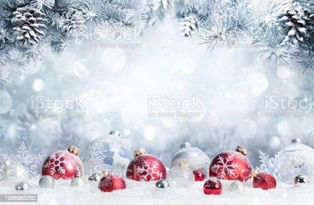 Merry christmas baubles on snow with fir branches picture id1066685262?b=1&k=6&m=1066685262&s=612x612&h=4csuw16g9kxus6zhs4em24mw2tysvfdjj zq3ztu6os=