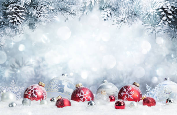 Merry Christmas - Baubles On Snow With Fir Branches Baubles On Snow With Snowy Christmas Tree christmas ornament stock pictures, royalty-free photos & images
