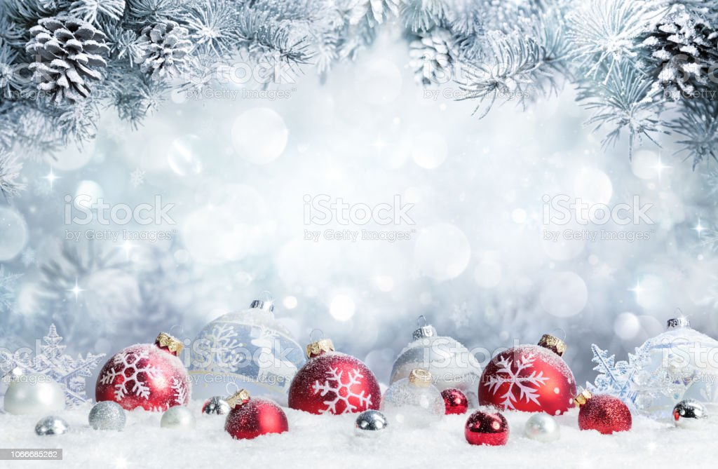 Merry Christmas - Baubles On Snow With Fir Branches stock photo