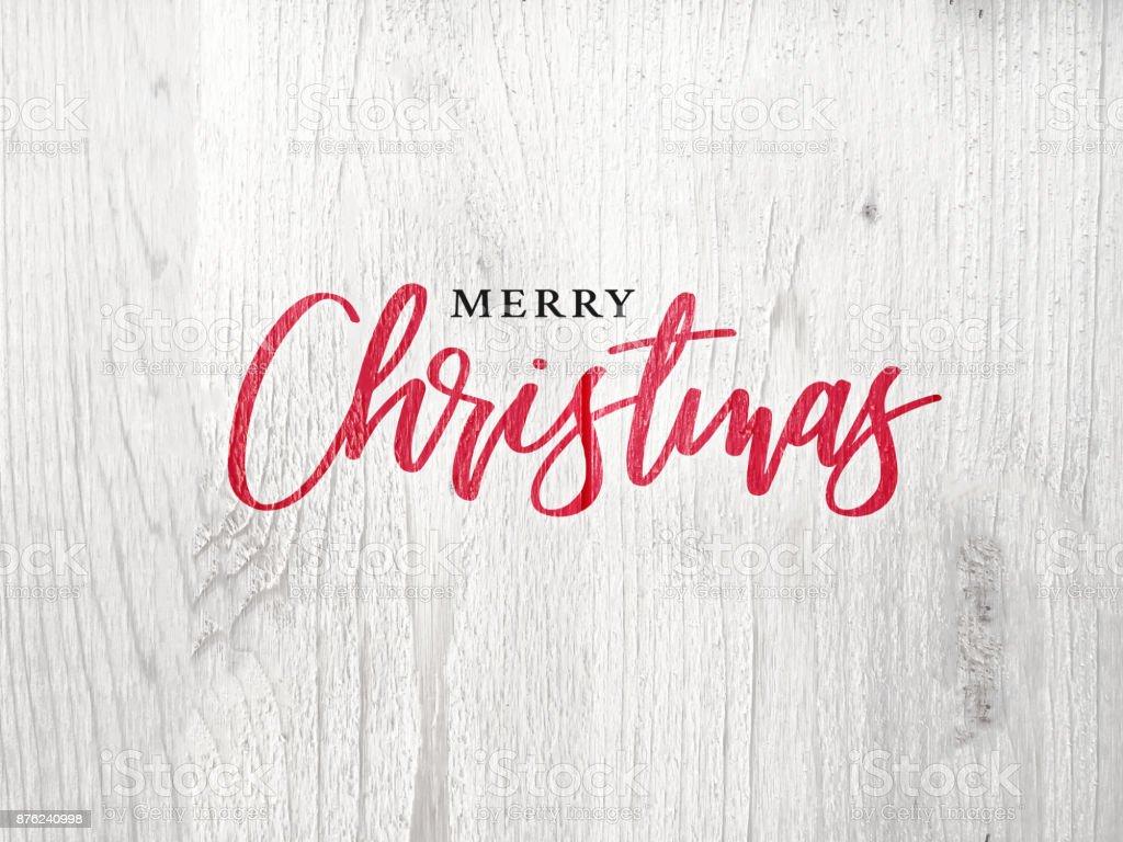 Feliz Navidad caligrafía texto sobre fondo blanco de madera rústico - foto de stock