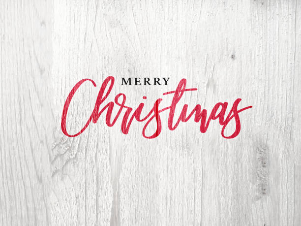 Merry Christmas Calligraphy Text Over White Rustic Wood Background stock photo