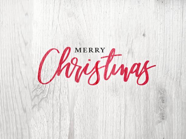 frohe weihnachten-kalligraphie-text über weiße rustikale holz hintergrund - weihnachtskarte stock-fotos und bilder