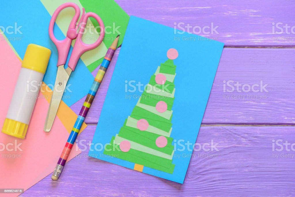 Merry christmas card scissors glue stick pencil colored paper on merry christmas card scissors glue stick pencil colored paper on purple wooden m4hsunfo