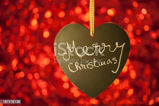 908708148 istock photo merry christmas card with heart blackboard table 187476136