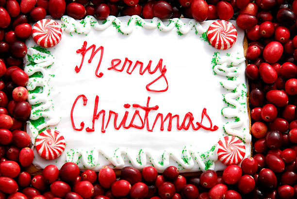 Merry Christmas Cookie Greeting with Cranberries stock photo