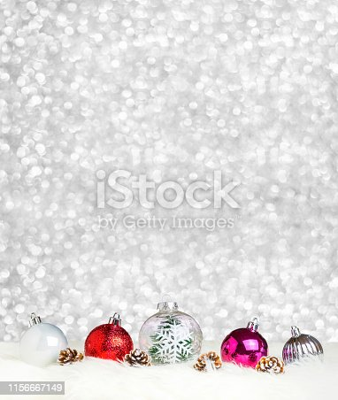 istock Merry Christmas decoration ball on white fur at silver bokeh light background,Banner vertical Holiday greeting card 1156667149