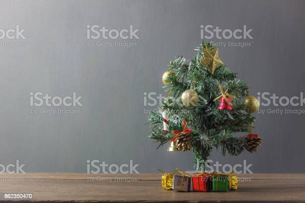 Merry christmas fir tree concept backgroundpresent gift box and on picture id862350470?b=1&k=6&m=862350470&s=612x612&h=kdllsj5ypyv1a4 tl24jgzcz7ktmhskubznimgqys9q=