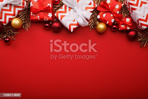 istock Merry christmas gift boxes background with christmas baubles 1056313692