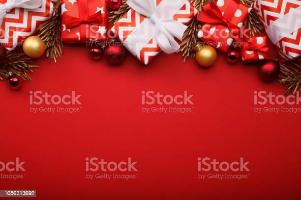 Merry christmas gift boxes background with christmas baubles picture id1056313692?b=1&k=6&m=1056313692&s=612x612&h=yk9s xd2e1jtmz3w18zkfrc5j2k0lab4uwkvhjb4aza=