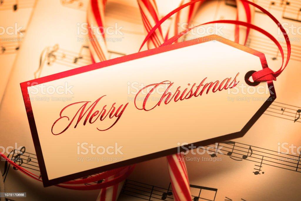 Merry Christmas Gift Tag On Sheet Music stock photo