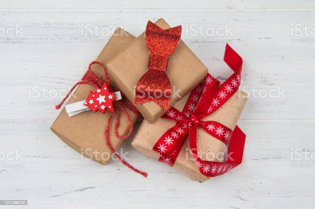 Merry Christmas. Gifts with red bows. Wooden table.