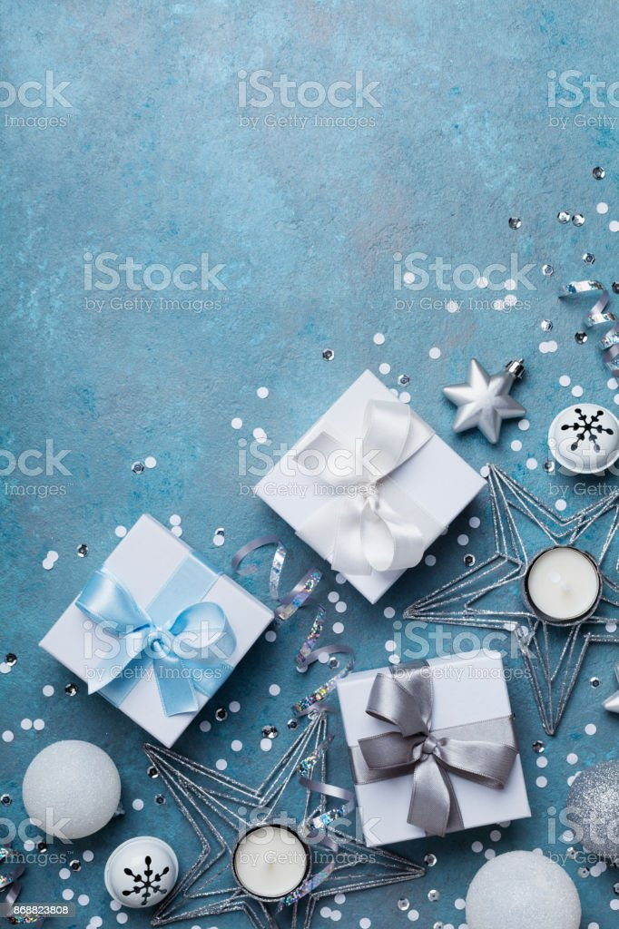 Merry christmas greeting card. Gift boxes and holiday decoration on blue table top view. Flat lay. stock photo