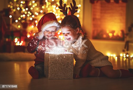istock Merry Christmas! happy children with magic  gift  at home 871741648