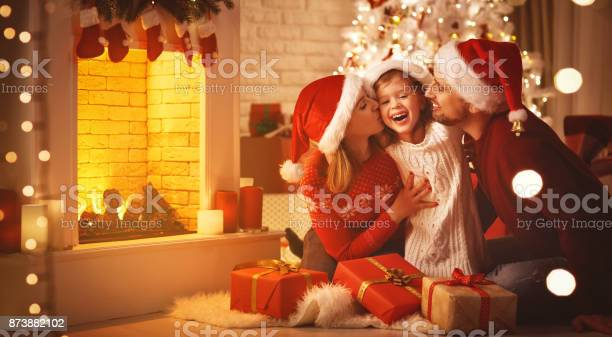 Merry christmas happy family mother father and child with gifts near picture id873882102?b=1&k=6&m=873882102&s=612x612&h=bsxbjm1uigduk8libxddnq7bxyzwl3r7wfr2pfcgeue=
