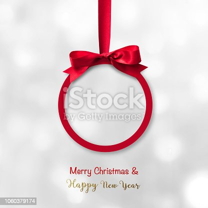 istock Merry Christmas  Happy New Year beautiful round Xmas red ball, shiny bow ribbon isolated on white background 1060379174