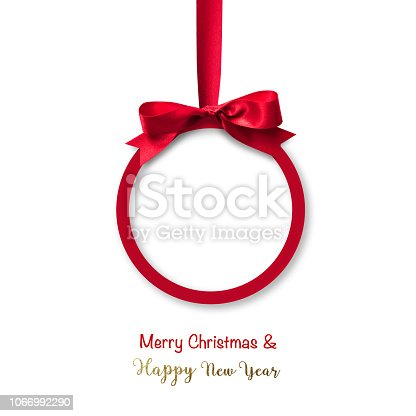 istock Merry Christmas  Happy New Year beautiful round Xmas red ball, shiny bow ribbon isolated on white background 1066992290