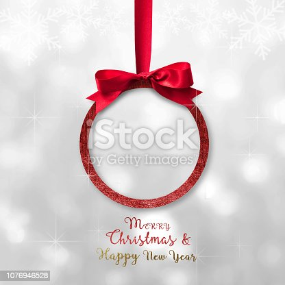 istock Merry Christmas  Happy New Year beautiful round Xmas red ball, shiny bow ribbon 1076946528