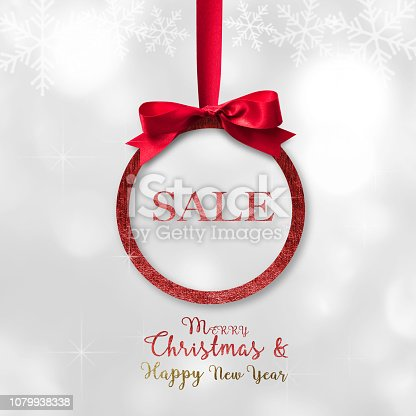 istock Merry Christmas  Happy New Year beautiful round Xmas red ball, shiny bow ribbon 1079938338