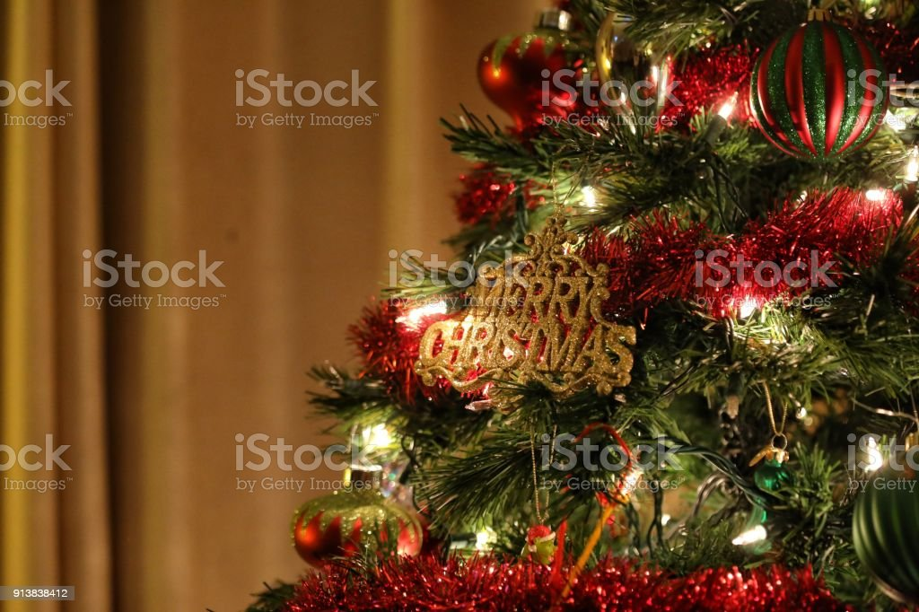 Merry Christmas Holiday Ornament On Red Green Gold Tree Background