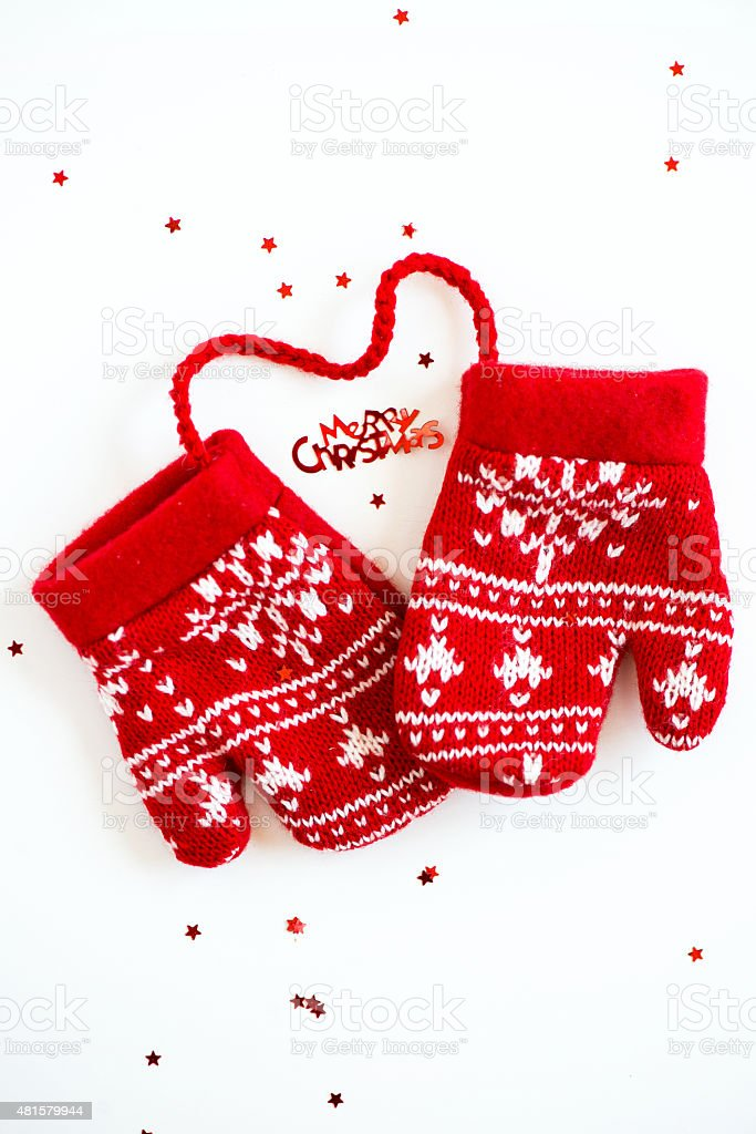 Merry Christmas letters, little Stars and Red Knitted Mittens wi stock photo