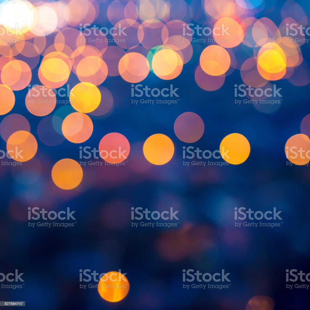 merry christmas lights abstract circular bokeh on blue stock photo