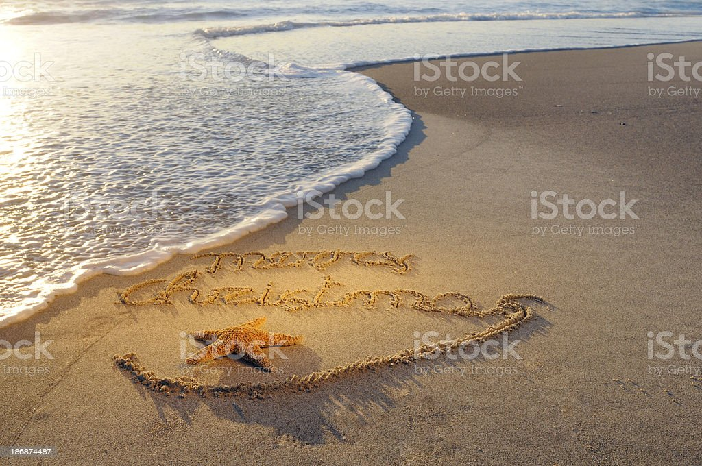 Merry Christmas Message in the Sand royalty-free stock photo