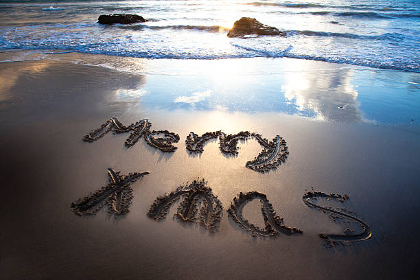 Merry christmas on the bech stock photo
