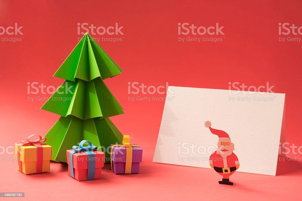 Merry christmas paper cut handmade card template stock photo