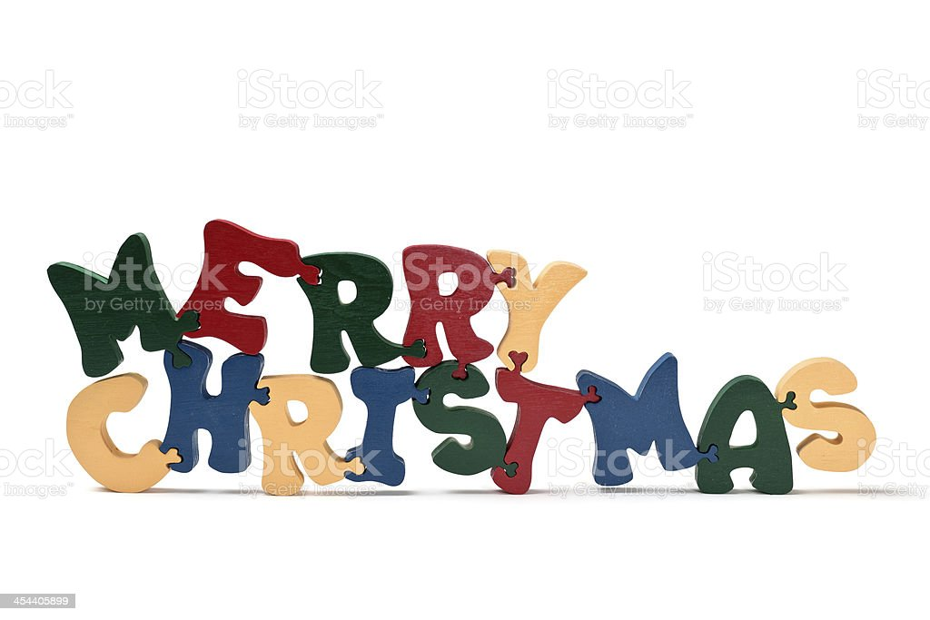 Merry Christmas: Puzzle Painted Wood Letters royalty-free stock photo