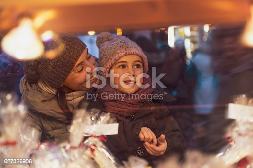 Family at christmas market at winter time in December - vintage look