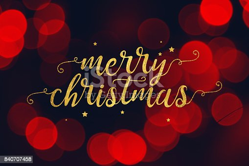 istock Merry Christmas Script and Stars with Red Bokeh Lights Background 840707458