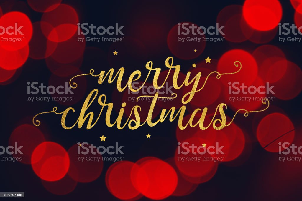 Merry Christmas Script and Stars with Red Bokeh Lights Background stock photo