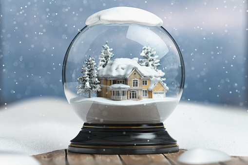 Merry christmas snow globe with a house on snowfall winter background.