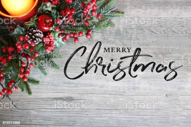 Merry christmas text candle pine tree branches and berries in top picture id876314968?b=1&k=6&m=876314968&s=612x612&h=umaqhiys vlf 7zvljwrh4dab3a47ne0g9jfsvgikbg=