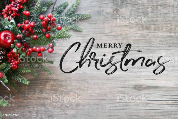 Merry christmas text with christmas evergreen branches and berries picture id876289252?b=1&k=6&m=876289252&s=612x612&h=47q 4zrhaljcsq5wnc0chjjeoqvxxxpxszjoah4pxta=