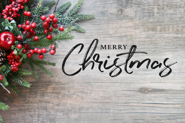 merry christmas text with christmas evergreen branches and berries over rustic wooden background - branch plant part stock pictures, royalty-free photos & images