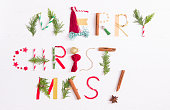 istock Merry Christmas - word on white wooden background 1180584008