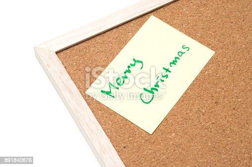 990092558 istock photo Merry christmas writen on yellow sheet, cork board 891840876