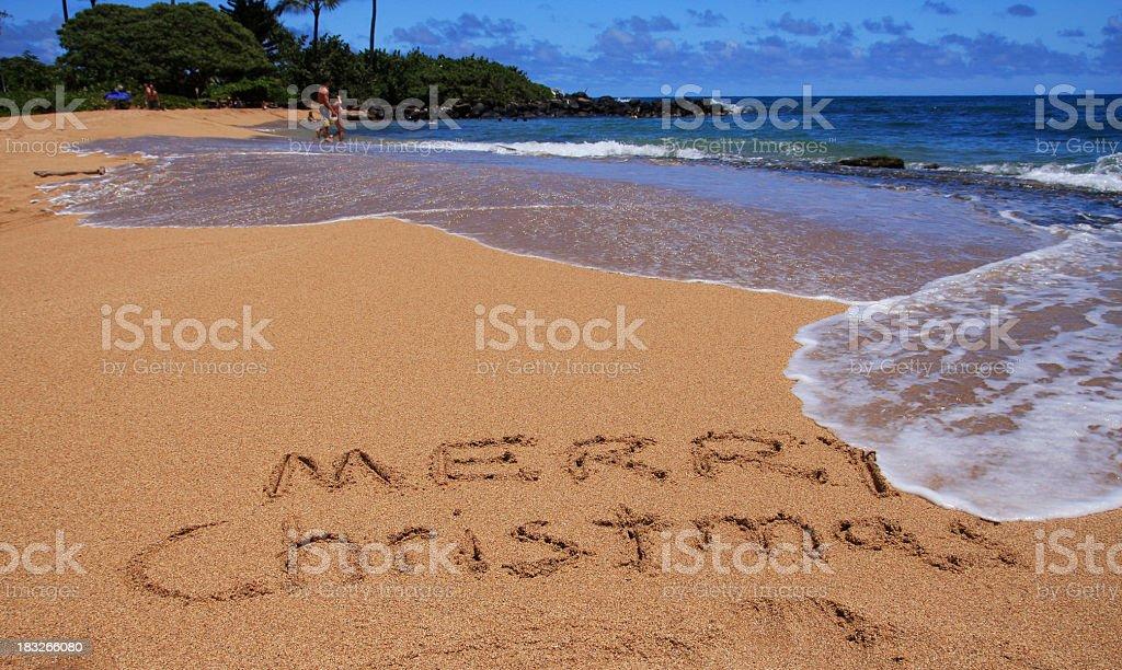 Merry Christmas written on Kauai Hawaii beach sand stock photo