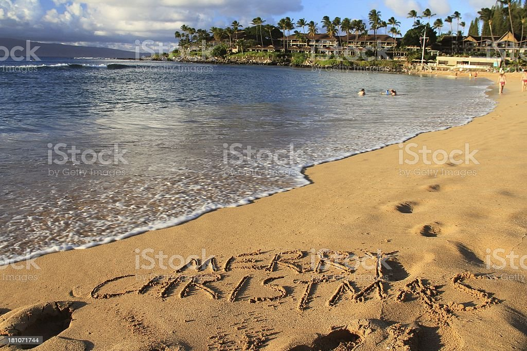 Merry Christmas written on Maui Hawaii resort hotel beach sand royalty-free stock photo