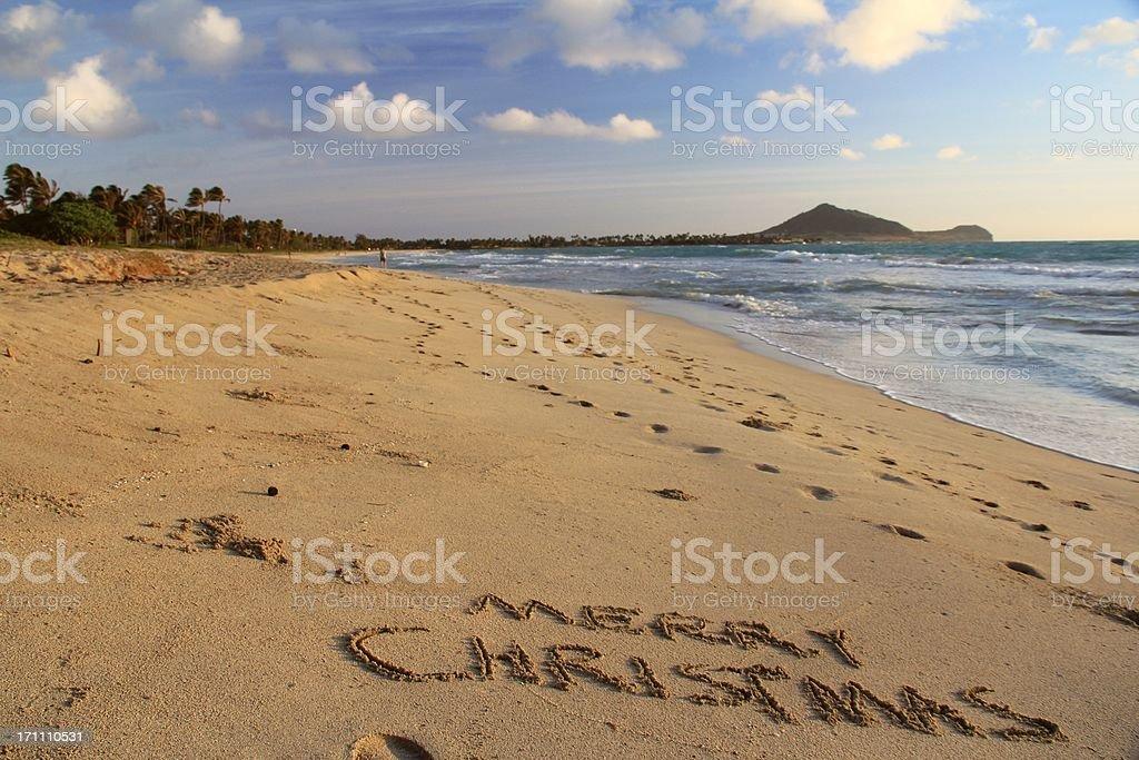 Merry Christmas written on Oahu Hawaii beach sand stock photo