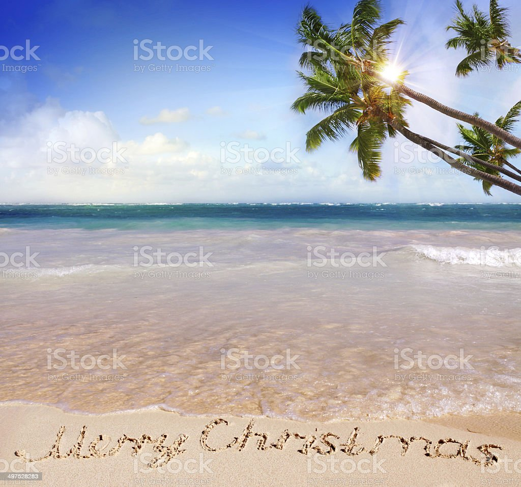 merry christmas written on tropical beach royalty free stock photo - Merry Christmas Beach Images