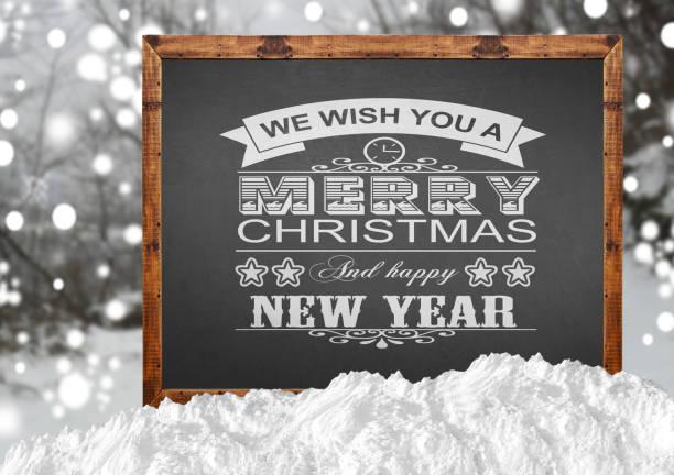 frohe weihnachten geschrieben auf holzbrett - weihnachtsspende stock-fotos und bilder