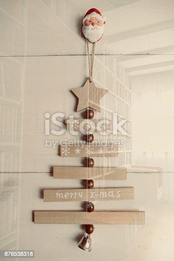 1057183432 istock photo Merry xmas tree hanging and books background 876538318