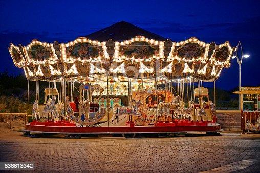istock Merry-go-round on the Promenade of the Belgian Seaside resort De Panne 836613342
