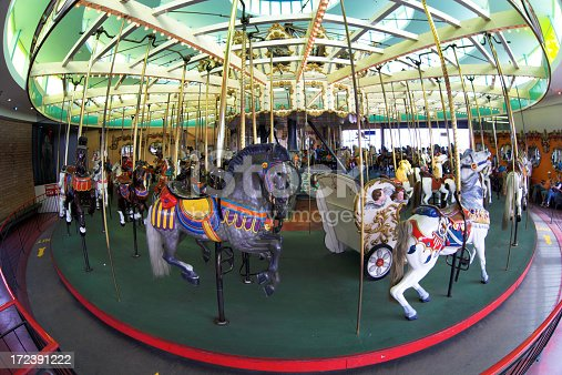 An old Merry-Go-Round or Carousel shot with a 15mm fisheye lens for a distorted prespective.