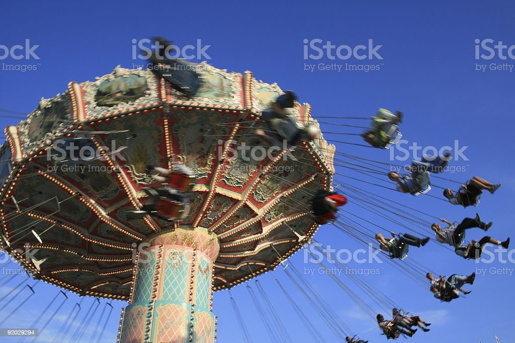 Merry-Go-Round swinging guests in the air royalty-free stock photo