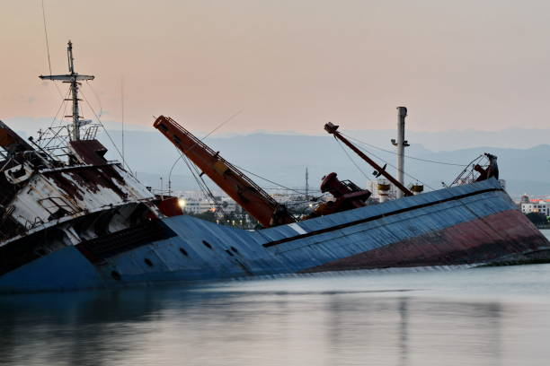 Mersin port and sinking ship stock photo