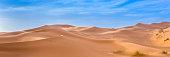 Merzouga in the Sahara Desert in Morocco. Afica. Web banner in panoramic view.