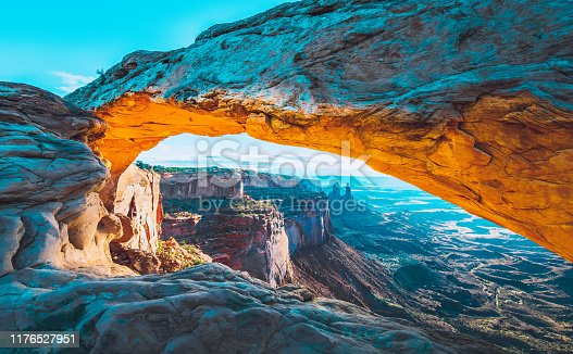 The sunrise at the Mesa Arch in the Canyonlands National Park makes the arch glow, Utah, USA.